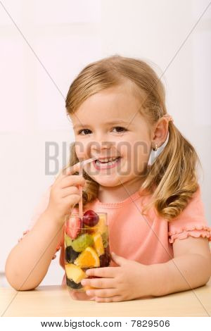 Happy Little Girl With Fruit Salad