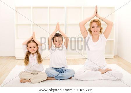 Family Doing Yoga Exercises