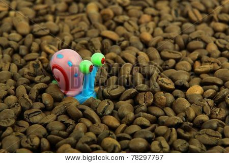 Snail And Coffee Beans