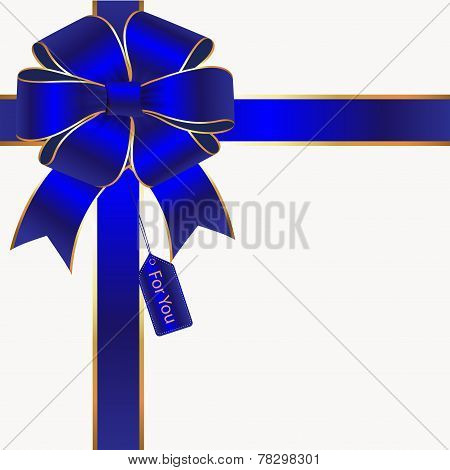 Blue And Gold Silk Bow And Ribbon With A Gift Tag