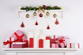 picture of cozy hearth  - Christmas decorations with candles on mantelshelf on white background - JPG