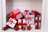 stock photo of cozy hearth  - Christmas gifts in fireplace - JPG