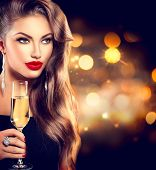 stock photo of christmas party  - Sexy model girl with glass of champagne at party - JPG