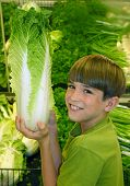 image of grocery store  - boy in produce at grocery store - JPG
