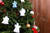 image of christmas angel  - Knitted Christmas angels on Christmas tree - JPG