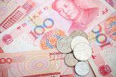 image of yuan  - Chinese yuan renminbi banknotes and coins - JPG
