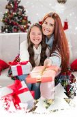 pic of blanket snow  - Festive mother and daughter wrapped in blanket with gifts against snow falling - JPG
