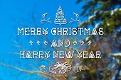 stock photo of blue spruce  - Merry Christmas and New Year hand drawing greeting card on blurred spruce or fir - JPG