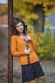 stock photo of clarinet  - the girl with the clarinet in his hands - JPG