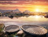 image of karnataka  - Round shape boats on Tungabhadra river at sunset sky in Hampi Karnataka India - JPG