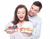 stock photo of sushi  - Eating sushi together - JPG