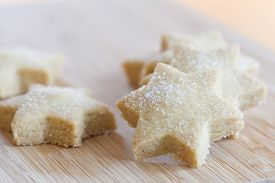 pic of desert christmas  - Star shaped Christmas cookies with sugar on a board  - JPG