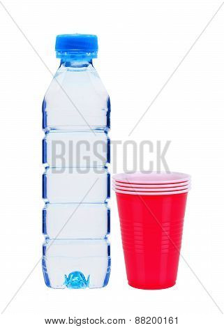 Blue Bottle With Water And Red Plastic Cups Isolated On White