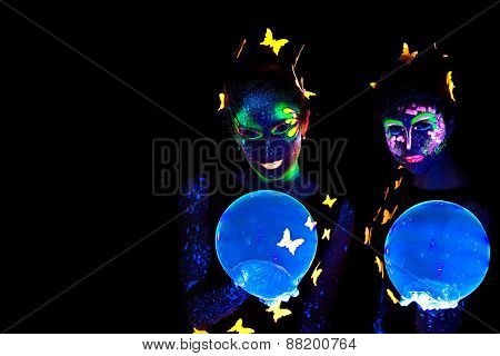 Two young woman with luminous make up and bubble