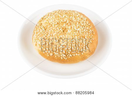 Appetizing Bun With Sesame Seeds On Glass Saucer