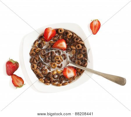 Chocolate Cereals And Strawberries For Breakfast Closeup. Top View