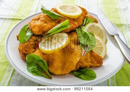 Fried Schnitzel With Herbs And Lemon