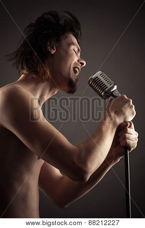 singer singing into retro microphone