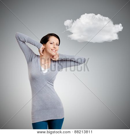 Beautiful woman touches her back of the head while stretching herself, isolated on grey background with cloud
