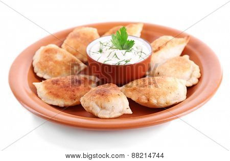 Fried dumplings with onion on plate, isolated on white