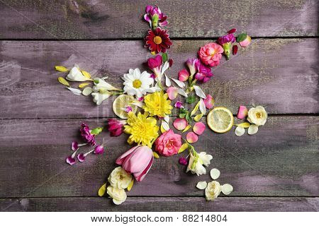 Smile of beautiful flowers, on wooden table