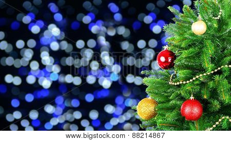 Decorated Christmas tree on festive shiny background
