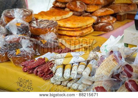 PISA, ITALY - APRIL 11, 2015: Traditional italian salami and bread on the market of Pisa in Italy. Pisa is a city in Tuscany known worldwide for the Leaning Tower, one of the biggest landmark.