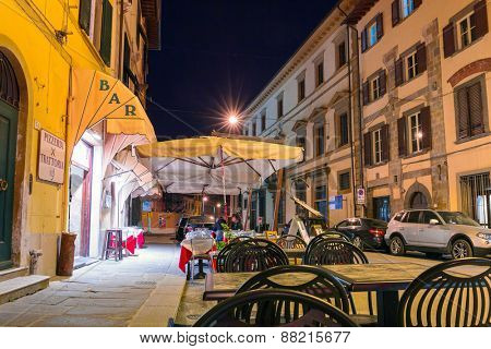 PISA, ITALY - APRIL 10, 2015: Streets of Pisa at night with traditional architecture of Italy. Pisa is a city in Tuscany known worldwide for the Leaning Tower, one of the biggest landmark.