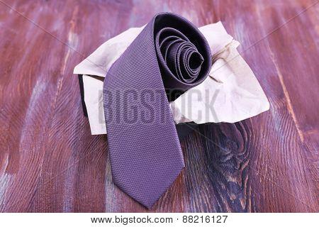 Male necktie in box on wooden background