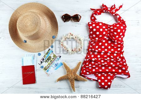 Set of things for summer holidays on wooden background