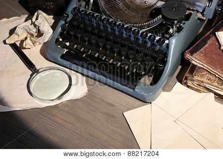 Retro typewriter on wooden table, closeup