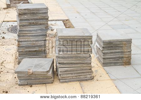 Stack Of Cement Floor Tiles At Road Side Construction Site