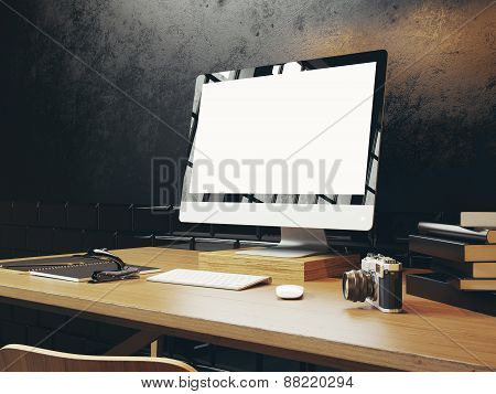 Mock Up Of Generic Design Computer Screen. Workspace In The Black Loft. 3D Rendering