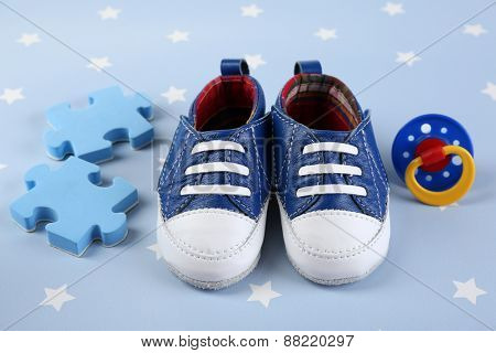 Baby shoes on blue background