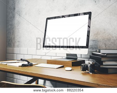 Mock Up Of Generic Design Computer Screen On The Table. Workspace In The White Loft. 3D Rendering
