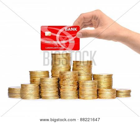 Many Coins In Column And Hand With Credit Card Isolated On White