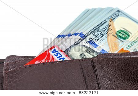 Wallet Open With A Dollar Bill Sticking Out And Credit Card, Isolated On White