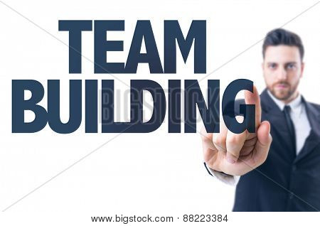 Business man pointing the text: Team Building