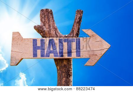 Haiti wooden sign with sky background