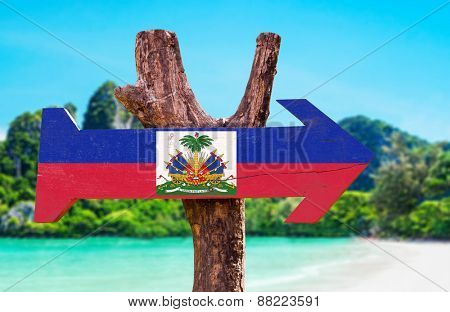 Haiti Flag wooden sign with beach background