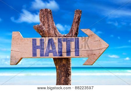 Haiti wooden sign with beach background