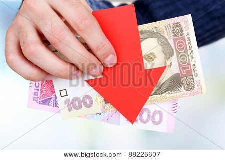Man holding money and red arrow close up