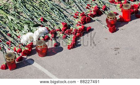 Mourning And Flowers On The Pavement