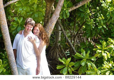 Beutiful Young Couple In A Tropical Jungle