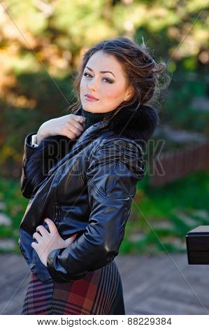 portrait of Young woman in black furry hood