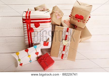 Beautiful gift boxes on wooden background. Valentine Day concept