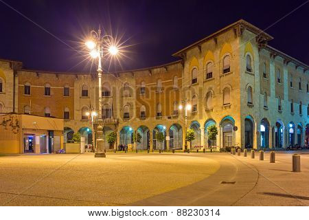 Streets of Pisa at night with traditional architecture, Italy