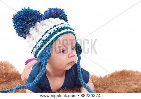 Portrait of adorable baby in knitted hat