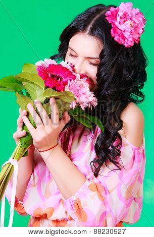 Spring Portrait Of A Pretty Young Brunette Smelling A Bunch Of Gerberas