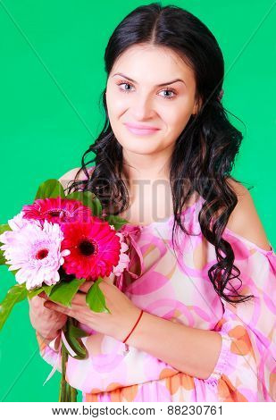 Spring Portrait Of A Pretty Young Brunette With A Bunch Of Gerberas